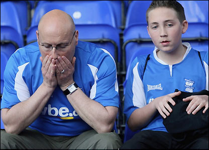 Dejected Birmingham fans after their team is relegated