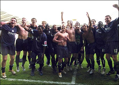 Southend's players celebrate promotion
