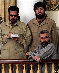 (From left to right) Jonathan Idema, Brent Bennett and Edward Caraballo, sitting, in court in 2004