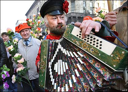 Russian man wearing a national costume and playing the accordion during the rally in Moscow
