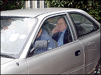 John Prescott in the back of a car leaving his home in the Sutton area of Hull