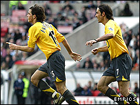 Cesc Fabregas, left, and Robert Pires