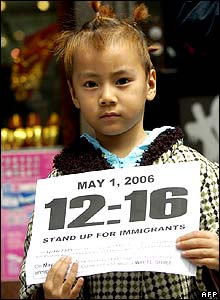 Young child holding sign