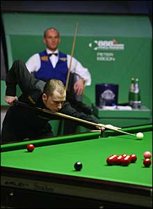 Graeme Dott at the table with Peter Ebdon watching on