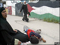 Woman begging in Gaza