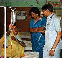 Doctor Gupta (right) on his rounds