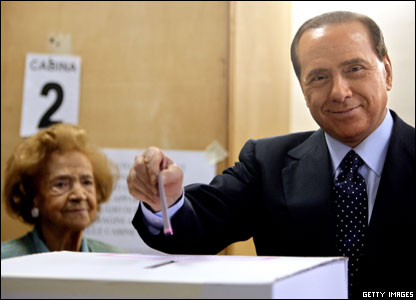 Berlusconi casts his vote in the Italian election under the watchful eyes of his mother Rosa at a polling station in Milan, 2006