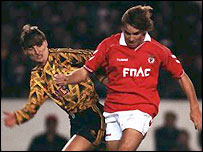 Arsenal's Colin Pates (left) tries to tackle Benfica's Sergei Yuran