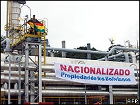 "A banner reading: ""Nationalised: Property of the Bolivians"" hangs from a gas installation at Carapari gas field in Tarija state, Bolivia"