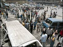 Iraqis gather at the scene of the blast at the Shorja market