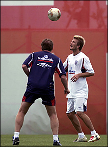 England coach Steve McClaren plays head tennis with captain David Beckham before the quarter-final againt Brazil