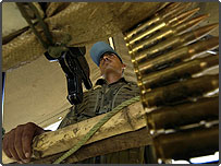 A UN peacekeeper steadies a weapon at his base in Katweguro, DR Congo