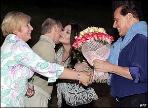 Russian President Vladimir Putin and wife Lyudmila greet Mr Berlusconi and wife Veronica