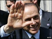 Silvio Berlusconi waving