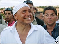 Silvio Berlusconi sporting a bandana on holiday in 2004