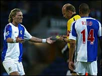 Robbie Savage, referee Steve Bennett and Steven Reid