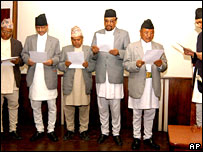 Prime Minister Girija Prasad Koirala (right) administers the oath of office to cabinet members