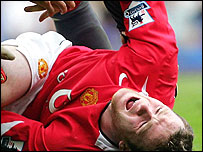 Wayne Rooney lies in agony after suffering a broken metatarsal