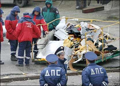 Investigators examine debris
