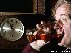 Customers drinking a pint with clock showing 2300