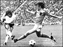 West Germany's Gerd Muller makes light of the attentions of Holland's Rudi Krol to score the winner in the World Cup final
