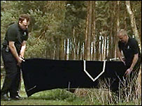 Police remove the human remains