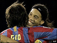 Ronaldinho embraces team-mate Giovanni van Bronckhorst after learning Barcelona have become Spanish champions for the second successive year