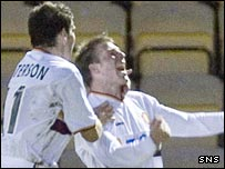 David Clarkson (right) celebrates scoring the winner for Motherwell