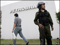 Security guard standing outside's Petrobras' main Bolivian office