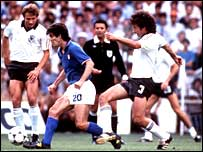 Italy's Paolo Rossi runs at the West Germany defence in the final