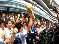 Diego Maradona holds the World Cup aloft