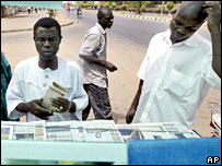 Nigerians reading newspapers