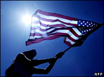 Woman waving a US flag