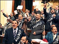 "Muslim Brotherhood MPs wear black sashes saying ""No to Emergency"" in Egyptian parliament"