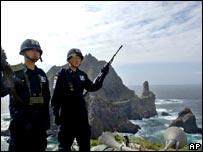 South Korean police officers stand guard on the Dokdo/Takeshima islands