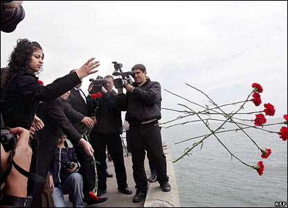 Armenians students throw flowers in the Black Sea near the resort of Sochi in Russia