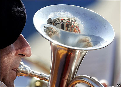 Swiss guard plays trumpet in St Peter's Square