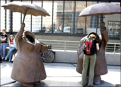 Woman inspects sculpture by director Terry Gilliam in Berlin, Germany