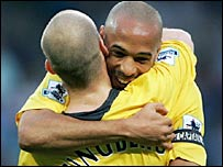 Arsenal scorer Freddie Ljungberg is congratulated by Thierry Henry