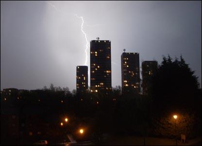 Lightning behind tower blocks