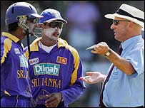 Umpire Mark Benson explains a decision