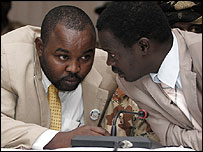 Darfur rebel leader Minni Minnawi talks to a fellow delegate