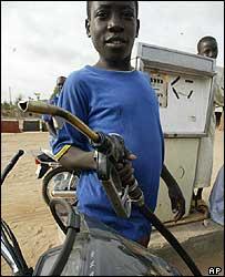 Nigerian boy selling petrol