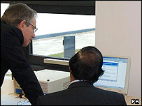 Tony Blair looks at a computer on a vist earlier this year