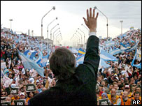 President Nestor Kirchner waves to crowds at the rally