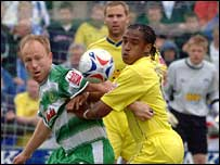 Yeovil's Paul Terry challenges Colchester's Neil Danns