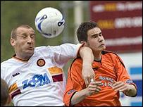 'Well goalscorer Jim Hamilton (left) battles for the ball
