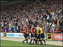 The Thistle players celebrate with their jubilant fans