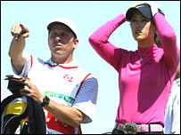 Michelle Wie consults her caddie at the SK Telecom Open