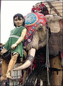 Girl and elephant in Piccadilly Circus, pic by Errol Russell